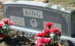 James W King