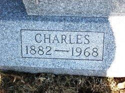 Charles F Delong