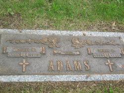 Russell M Adams